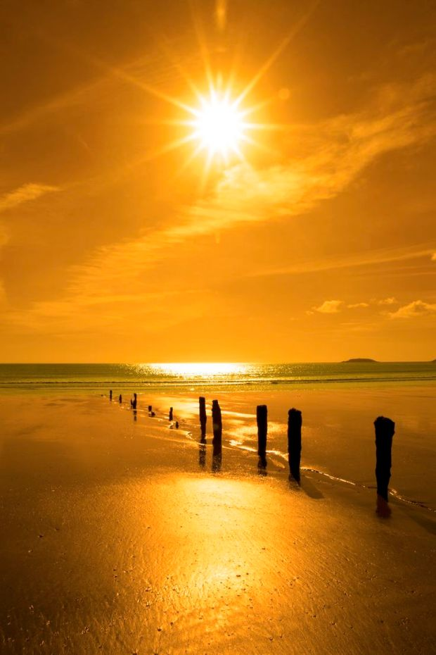 golden sunset over the beach breakers David Morrison