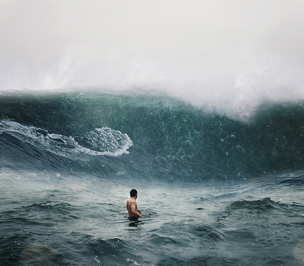 man facing surf