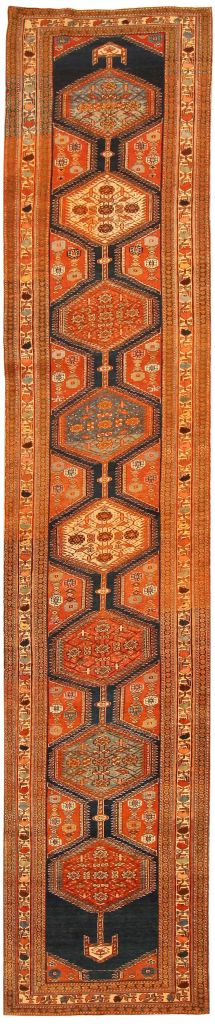 navy and orange antique rug