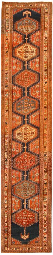 navy and orange antique rug