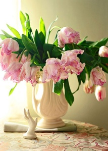 pink tulips in white vase