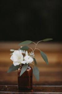 white flowers_brown bottle