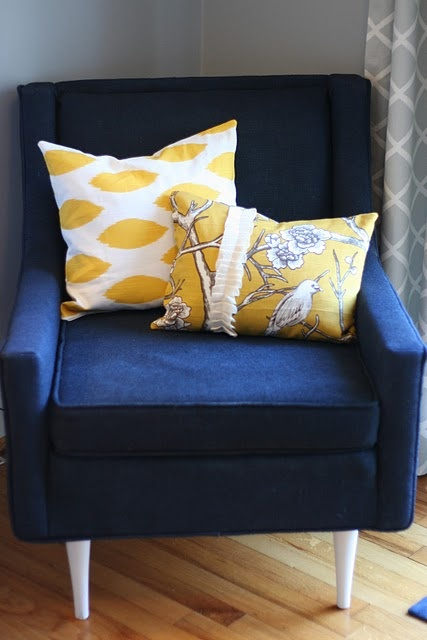 navy and yellow chair and pillows