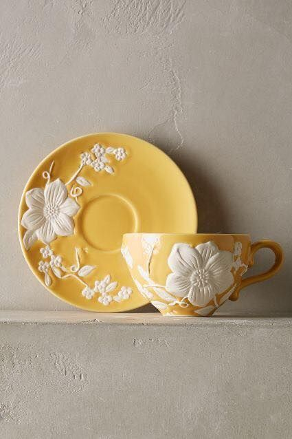 yellow and white cup and saucer