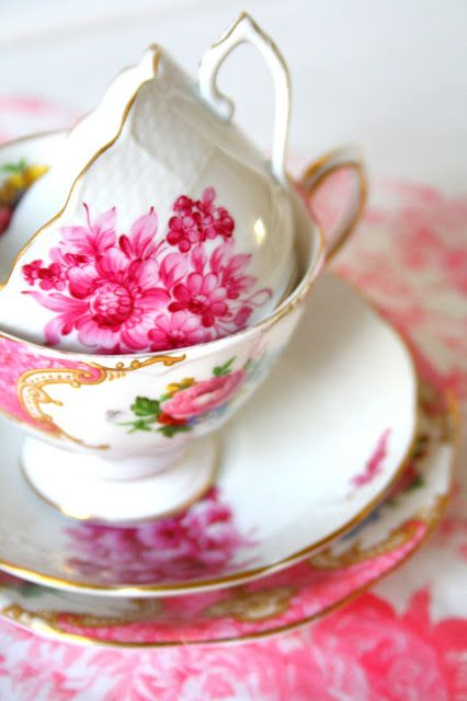 Tea cups with pink roses