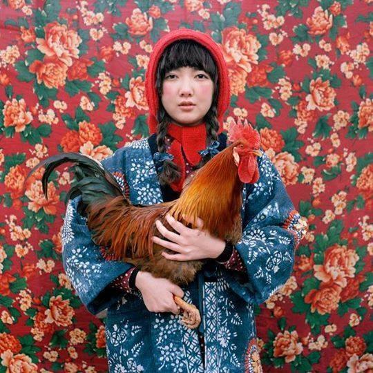 Woman in prints with chicken via Nadra's Unpolitical World