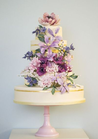purple flowers cake via ritzybee.typepaddotcom