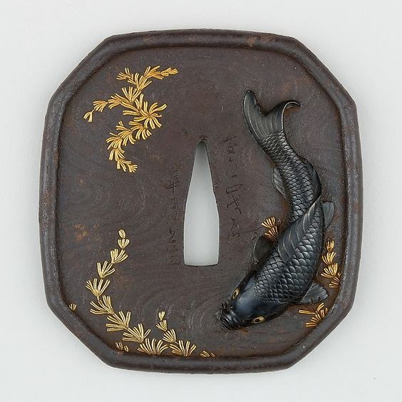 Koi carp tsuba from Japan. Iron, copper-gold alloy (shakudō) with gold and copper inlay from the Metropolitan Museum