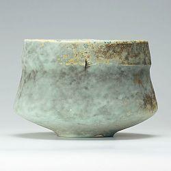Grey and lemon ribbed bowl by Jack Doherty
