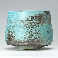 Turquoise orange ribbed bowl by Jack Doherty