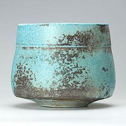 Turquoise orange ribbed bowl by Jack Doherty